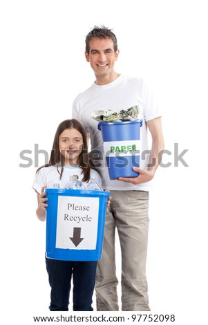 Portrait of happy father and daughter holding recycle bin. - stock photo