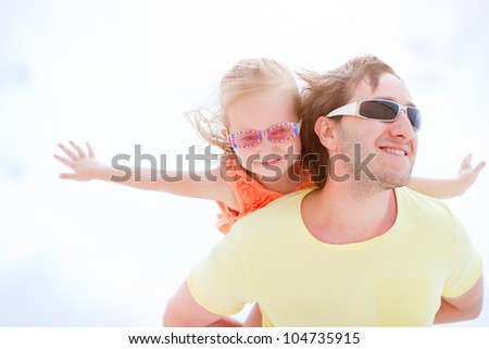 Portrait of happy father and daughter outdoors on summer sunny day