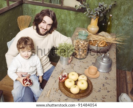 portrait of happy father and son in kitchen
