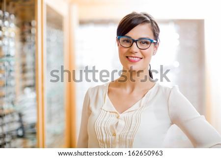 Portrait Of Happy Female Customer Wearing Glasses In Store