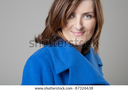 Portrait of happy forty years old woman in studio