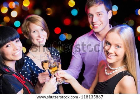 Portrait of happy friends wishing you Merry Christmas