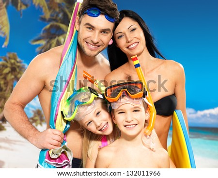 Portrait of  happy fun beautiful family with two children at tropical beach with protective swimming mask