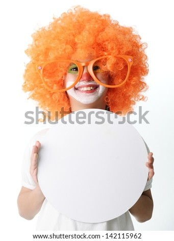 Portrait of happy funny clown kid holding circle copy space banner for your message