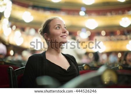 Portrait of happy girl in auditorium of opera teatre Сток-фото ©