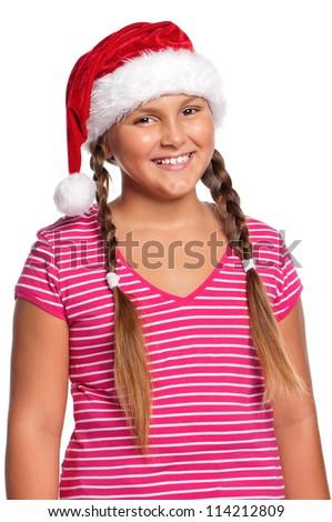Portrait of happy girl in Santa hat over white background