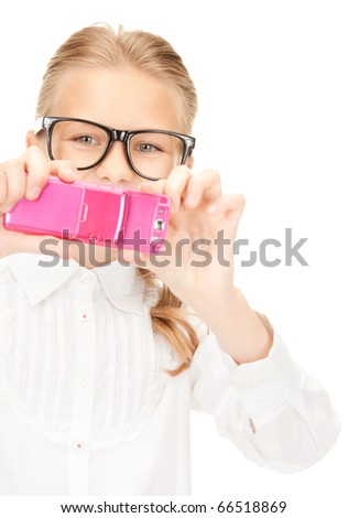 portrait of happy girl taking picture with cell phone