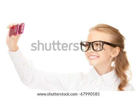 portrait of happy girl taking picture with cell phone - stock photo