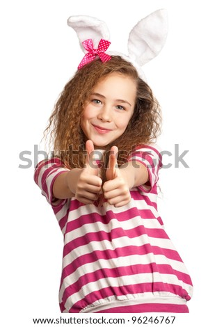 Portrait of happy girl with bunny ears isolated on white background - stock photo