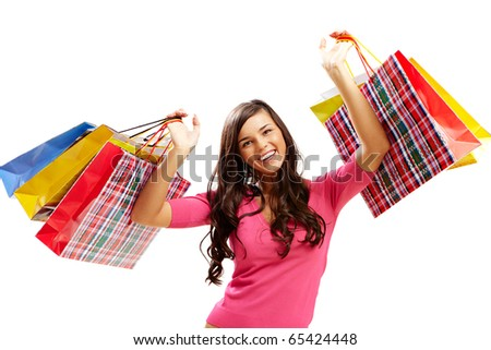 Portrait of happy girl with colorful paper bags looking at camera and smiling - stock photo