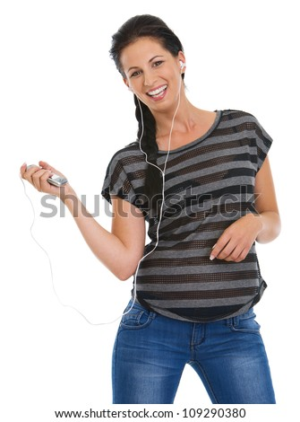 Portrait of happy girl with headphones listening music