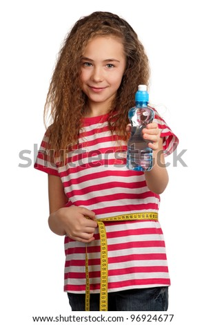 Portrait of happy girl with water from plastic bottle isolated on white background