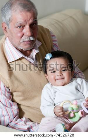 portrait of happy grandfather and grand daughter, grandfather and grandchild