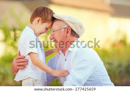 portrait of happy grandfather and grandson bow their heads Stock photo ©