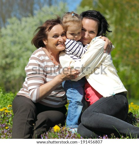 Portrait of happy grandmother, daughter and granddaughter outdoors