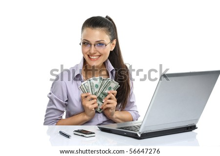 Portrait of happy greedy for money woman with a fan of American dollar using laptop