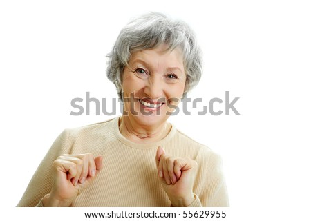 Portrait of happy grey haired woman looking at camera