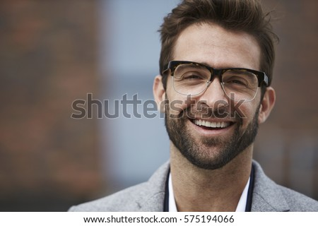 Portrait of happy guy in spectacles - Shutterstock ID 575194066