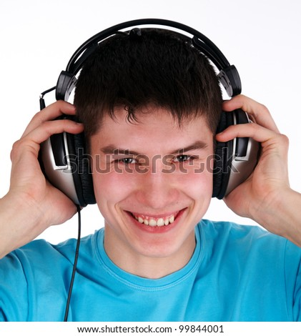 Portrait of happy guy listening music by headphone