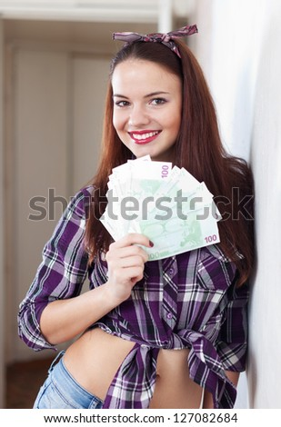 Portrait of happy housewife with many euro