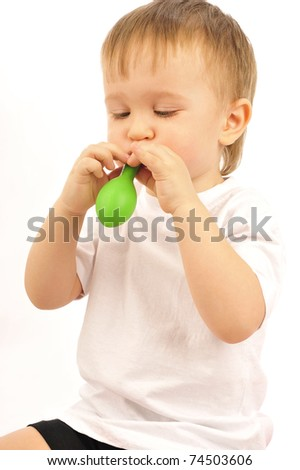 Portrait of happy joyful beautiful little boy isolated on white background playing with balloons