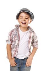 Portrait of happy joyful beautiful stylish little boy in hat isolated on white background