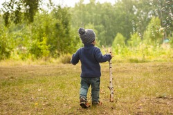 Portrait of happy joyful child on the forest background photo