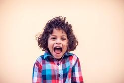 Portrait of happy joyful laughing little boy