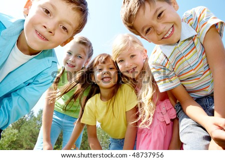 Portrait of happy kids outdoor looking at camera