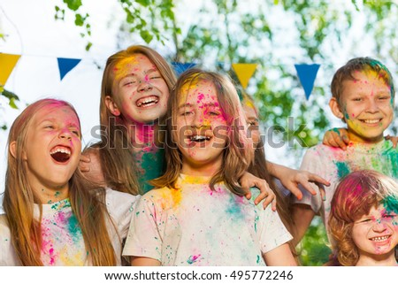 Portrait of happy kids smeared with colored powder #495772246