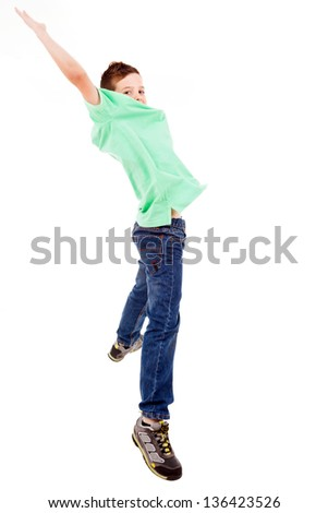 Portrait of happy little boy jumping with outstretched arms isolated on white background