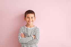 Portrait of happy little boy on color background