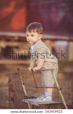 Portrait of happy little boy. outdoors