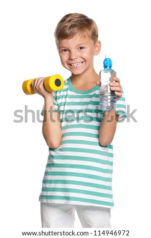 Portrait of happy little boy with dumbbells and bottle of water isolated on white background