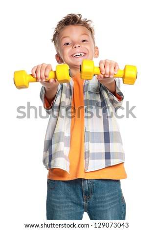 Portrait of happy little boy with dumbbells isolated on white background