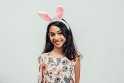 Portrait of happy little girl celebrating easter over white background