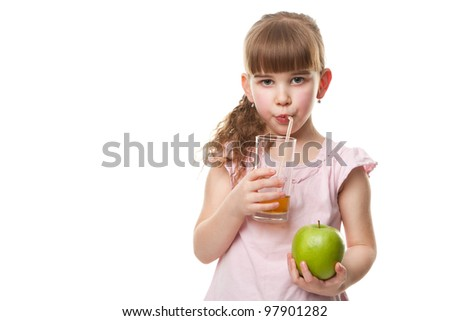 Portrait of happy little girl drinking  juice and holding green apple. Isolated on white. Health concept