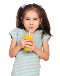 Portrait of happy little girl drinking orange juice