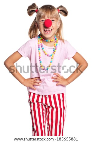 Portrait of happy little girl with red clown nose isolated on white background