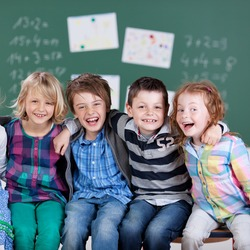 Portrait of happy little students during the break time in school