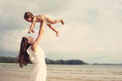 Portrait of happy loving mother and her baby outdoors