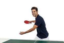 Portrait of happy male athlete playing table tennis on white background