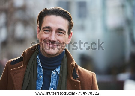 Portrait of happy male walking on street. He looking at camera. Relax concept. Copy space
