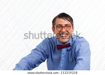 Portrait of happy man on wallpaper.