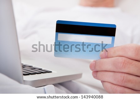 Portrait Of Happy Mature Man Shopping Online