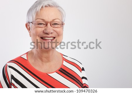Portrait of happy mature woman in striped top.