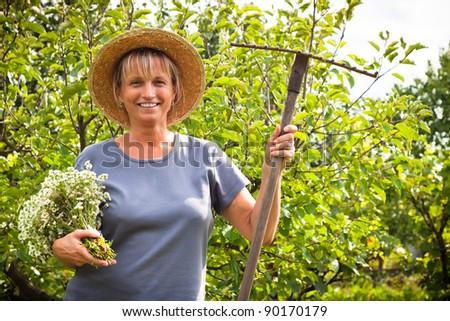 Portrait of happy mature woman in the garden.