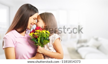 Portrait of happy mother and daughter holding #1181814373