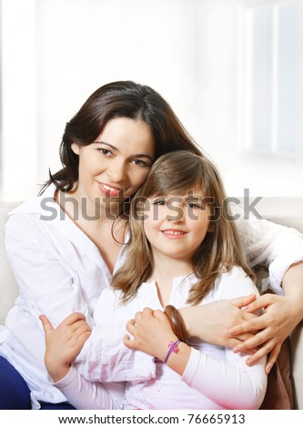 Portrait of happy mother and her smiling daughter