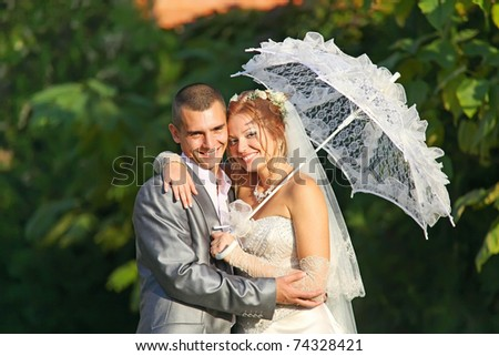 Portrait of happy newlyweds outdoors